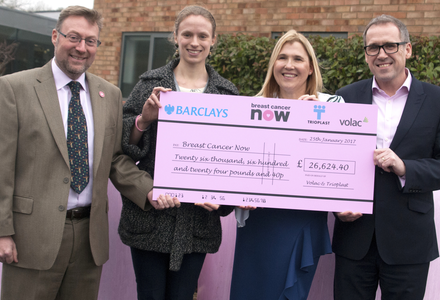 Handing over a charity cheque from pink bales campaign listing
